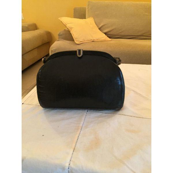 82002cb84b6 Μικρή δερμάτινη τσάντα χειρός - € 40 - Vendora.gr